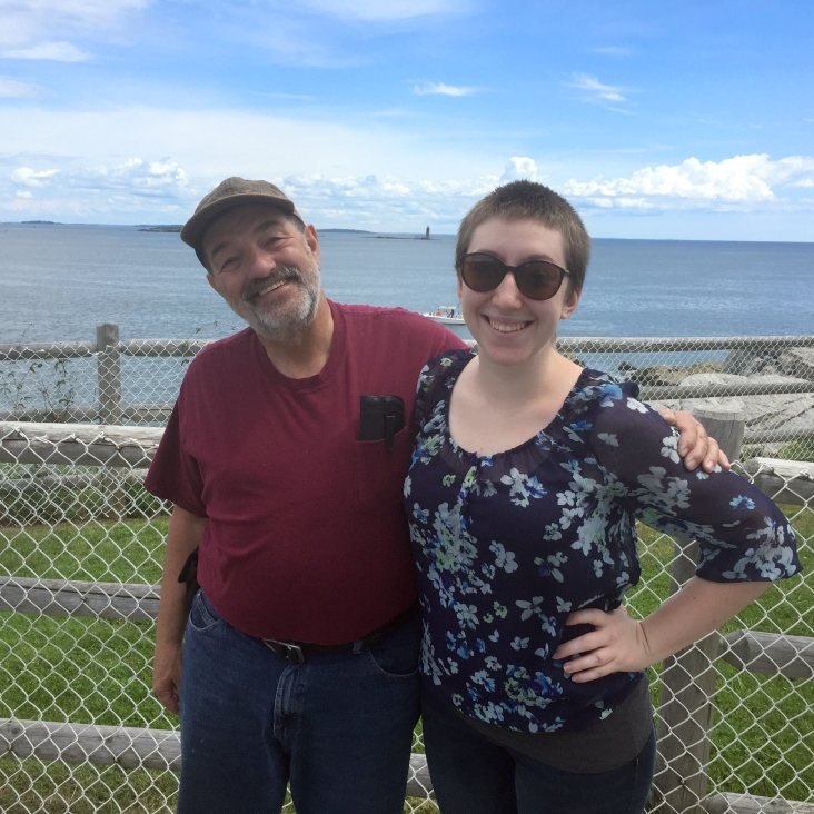 Papa John and Megan with Ram Island in the background.