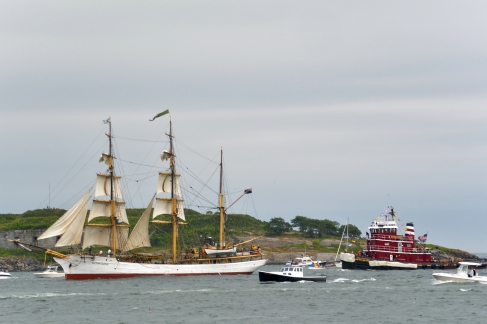 The Picton Castle and a tug boat.